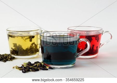 Butterflu Pea Tea. Blue Herbal Hot Tea. Three Glass Cups With Blue, Red And Green Tea With Dry Tea L