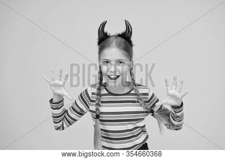 Im Too Cute To Spook. Small Child Dressed For Halloween Party. Little Girl Wear Halloween Red Devil