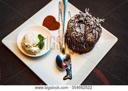 Cake, Ice Cream, Chocolate. Chocolate Fudgy Brownie With Vanilla Ice Cream And Chocolate Syrup On Wh