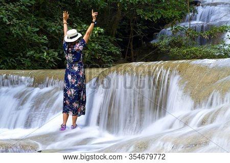 Traveler Stand Enjoy In Waterfall  At Erawan Waterfall And  Natural In Kanchanaburi Province Thailan