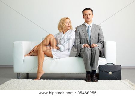 Lovely woman looking disappointed failing to seduce a serious businessman
