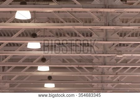 Ceiling In The Hangar. The Lights On The Ceiling In A Large Room. White High Ceilings.