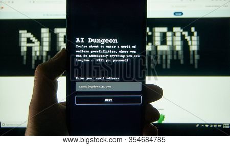 Montreal, Canada - March 08, 2020: Ai Dungeon Adventure Text Game On A Cell Phone Over Laptop Screen
