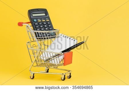 Shopping List, Check Out And Payment Or Shopping Calculation Concept, Calculator, Notepad And Pen Fo