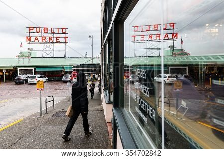 Seattle, Washington, Usa - October 9, 2019: Man In Black Coat Walking In To Shop In Public Market Of