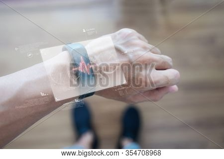 Smart Watch And Smart Gadget Technology. Hand Using Futuristic Smart Watch Monitoring Health Data