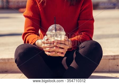 Woman Is Sitting And Holding A Disposal Cup Of A Delicious Frappe