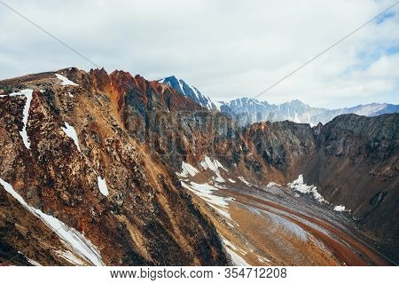 Atmospheric Alpine Landscape With Great Rockies And Unusual Glacier Tongue Covered With Stones. Beau