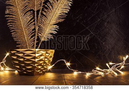 Holiday Dark Interior In Vintage Style With Decorative Golden Branch, Warm Electric Lights, Transpar