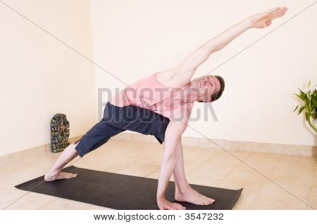 Attractive Mature Man Doing Yoga