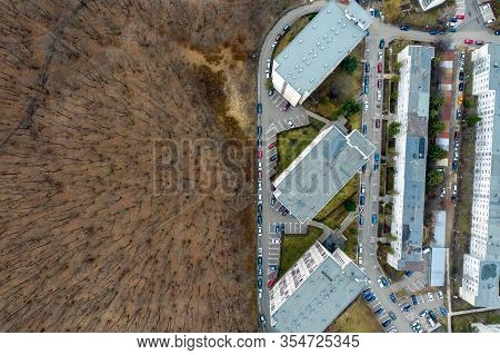 Aerial Photo Of Urban Environment, City Taking Place Of Nature. Expanding Flat Of Blocks Occupy Virg