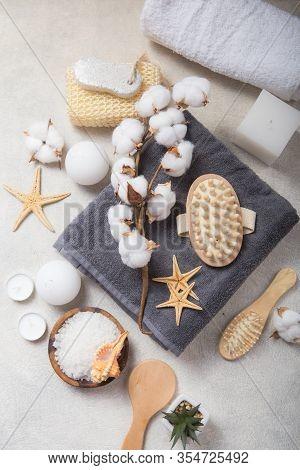 Spa Beauty Cosmetic Products And Tools On White Concrete  Background. Top View Copy Space.spa Concep