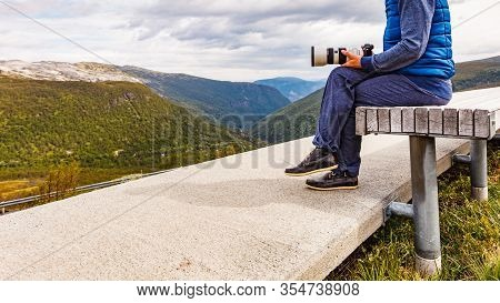 Woman With Camera Resting Taking Photo From Vedahaugane Bench Rest Stop. National Tourist Route Aurl