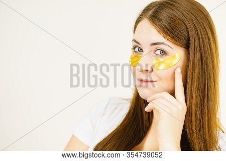 Woman With Gold Patches Under Eyes