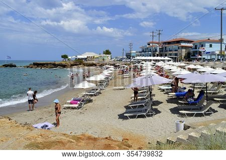 Kato Gouves, Crete, Greece - June 3, 2019 : Tourists On Kato Gouves Beach In Crete The Largest And M