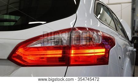 Red Rear Taillight Of A Modern Car Close-up. Service, Repair, Body Repair, Body Painting, Spare Part