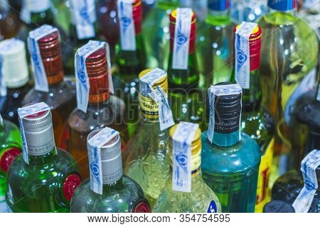 Rows Of Bottles Of Various Types And Brands Of Alcoholic Beverages. Concepts Of Habits, And Occasion