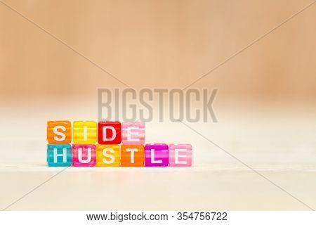 Side Hustle Phrase Made Of Cube Beads Of Different Colors. Concept Of Additional Income.