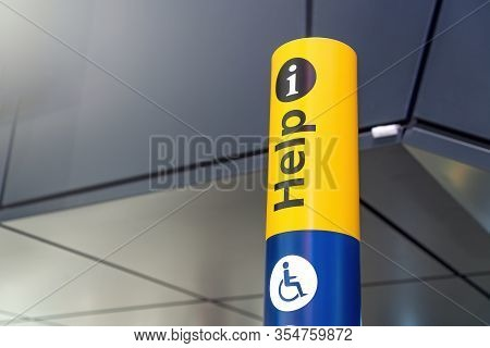 Help Desk, Meeting Point, Information Sign For Disabled Person And Tourist At The International Airp