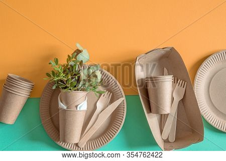 Eco Craft Paper Tableware. Paper Cups, Plates, Bag, Fast Food Containers And Wooden Cutlery With Cor