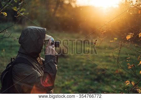 Senior Man Taking Photo In Nature. Man Photographing Autumn Forest.