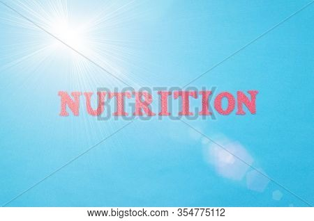 Dietetics Word In Red Letters On A Blue Background. The Concept Of The Section Of Medicine That Deal