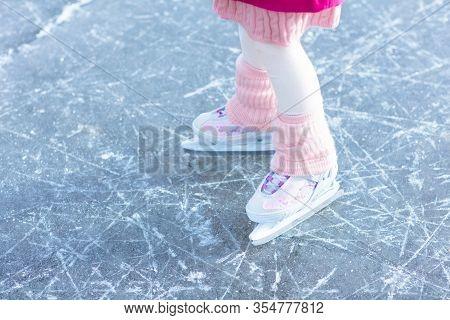 Child Ice Skating On Frozen River. Kids Skate.
