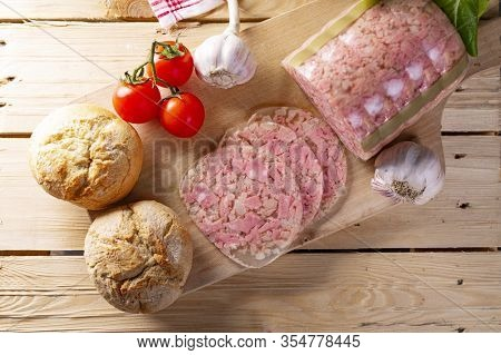 Headcheese On Wooden Cutting Board, Top View. Brawn. Pork Cold Cuts.