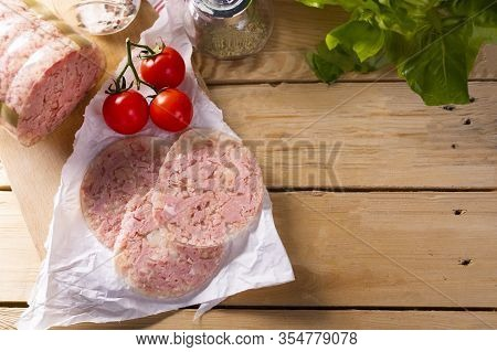 Headcheese On Wood Background, Top View. Brawn. Pork Cold Cuts.