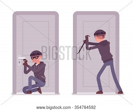 Thief Trying To Break Into The Door. Masked Housebreaker Working With A Burglary Tool, Master Key, P
