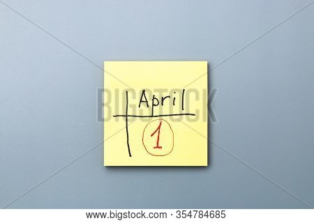 April Fools Day Reminder On Yellow Sticky Note. Be Aware And Do Not Let Be Fooled