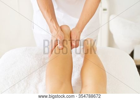 Massage And Physiotherapy To A Woman On Her Feet