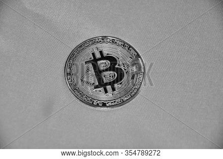 Single Physical Bitcoin In B/w Format. Blockchain Technology.