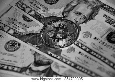 E-business Concept - Bitcoin And Dollars In B/w