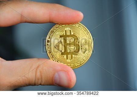 Bitcoin Holding By Man - Currency Concept