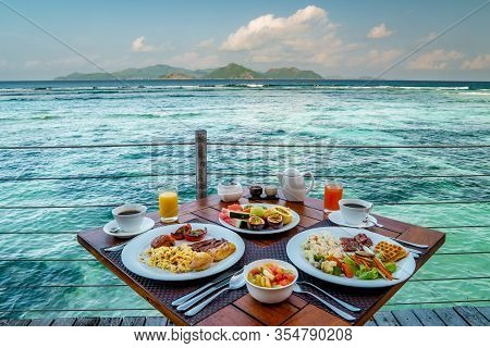 Breakfast On The Beach By The Pool With A Look Over The Ocean Of La Digeu Seychelles