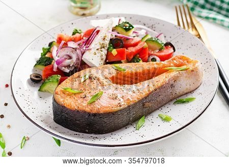 Ketogenic Lunch. Baked Salmon Garnished With Greek Salad. Healthy Dinner. Keto/paleo Diet.