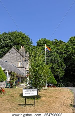 Weston-super-mare, Uk - July 26, 2018: The Pride Flag Flies Over Grove House, The Headquarters Of We