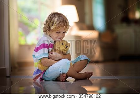 Child Playing With Teddy Bear. Kid And Toy At Home