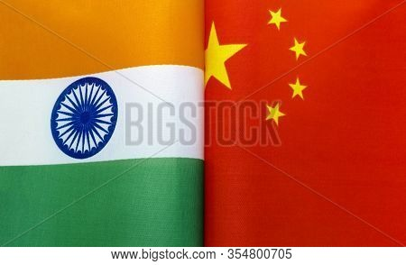 Fragments Of National Flags Of India And China Close-up