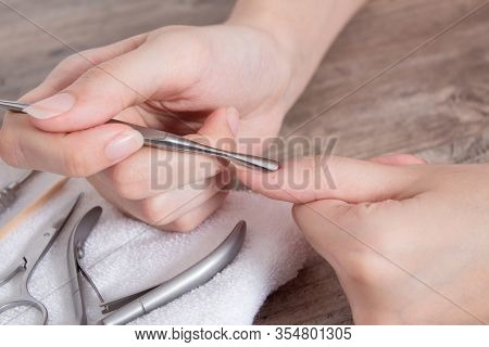 Manicure. Push Back The Cuticle With A Metal Pusher. Getting Injured During A Manicure. Skin Care, H