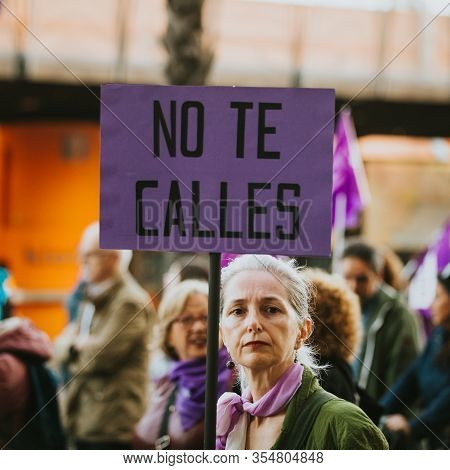 Malaga, Spain - March 8th, 2020:  Woman Showing Feminist Banner During Feminist Strike In Malaga, Sp