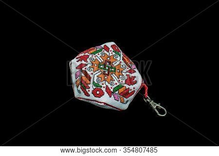 Traditional Bulgarian Cross Stich Pattern Made For A Keychain Isolated On Black