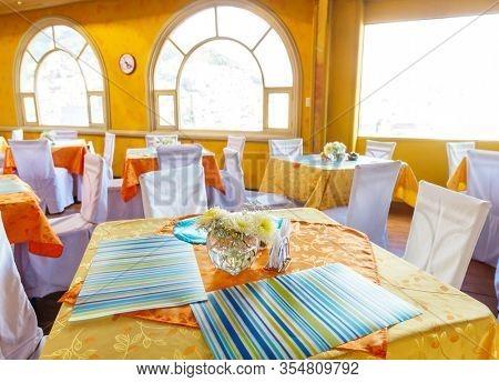 Restaurant interior in yellow and orange design