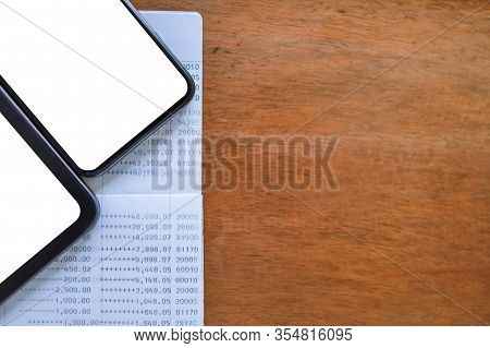 Technology, Business, Finance And E-commerce Concept. Top View Of Smart Mobile Phone And Computer Ta