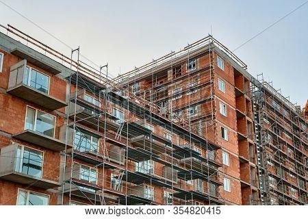 Apartment building block of flats under construction in a city urban area, brick building