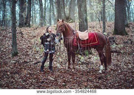 Warrior Woman With Her Brown Horse Into The Woods - Beautiful Scandinavian Viking Girl - Medieval Ci