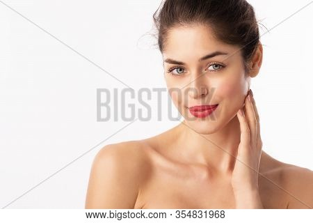 Beautiful Young Woman Wearing Red Lipstick While Posing At Isolated White Background