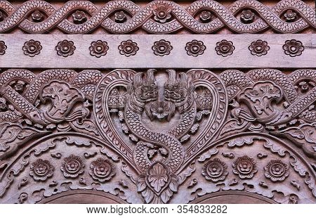 Exterior Detail - Ancient Wooden Bas-relief With Nagas And Flowers At Vihara Of Luang Pu Mun Monaste