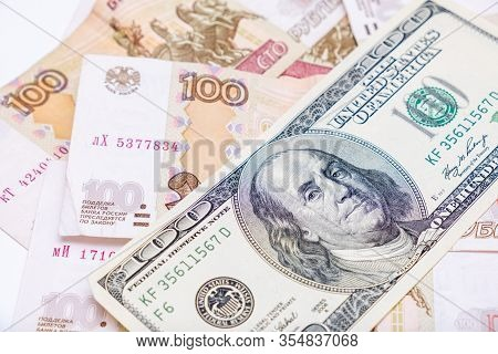 Us Dollars Banknotes Lying Over Russian Rubles Background, Financial Crisis And Choosing Currency Fo
